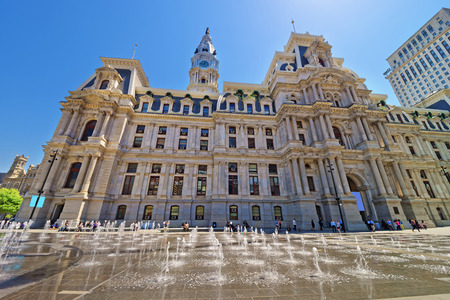 Philadelphia City Hall with the fountain on Penn Square. Tourists on the square. Pennsylvania, USA. Editorial