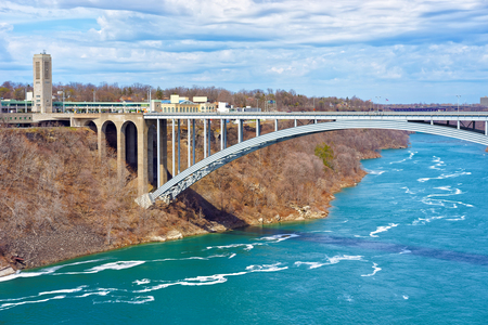 niagara river: International Rainbow Bridge over Niagara River Gorge from American side near Niagara Falls. It is an arch bridge between the United States of America and Canada. Stock Photo