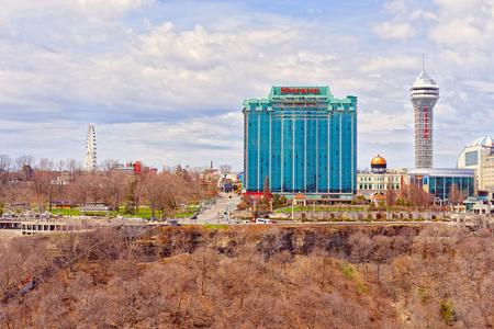 niagara falls city: Ontario, Canada - April 30, 2015: Cityscape in Ontario near Niagara Falls, viewed from American part. Niagara River is a border between the United States of America and Canada.