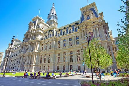 Philadelphia, USA - May 4, 2015: Philadelphia City Hall with many tourists on Penn Square. Pennsylvania, USA.