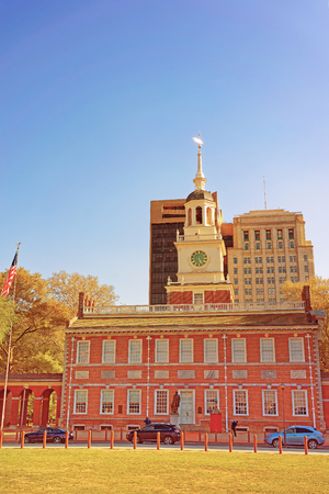 center hall colonial: Independence Hall in Chestnut Street of Philadelphia, Pennsylvania, USA. It is the place where the US Constitution and the US Declaration of Independence were adopted. Tourists in the street Editorial