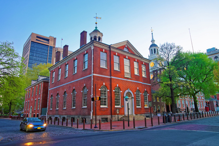 Independence Hall and Old City Hall in Philadelphia, Pennsylvania, USA in the evening. It is the place where the US Constitution and the US Declaration of Independence were adopted. Stock Photo