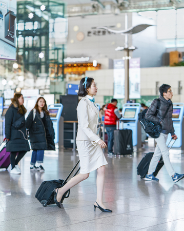 incheon: Incheon, South Korea - February 15, 2016: Asian Korean air flight stewardess at International airport of Incheon. It is one of the largest and busiest world airports.