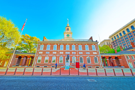 Independence Hall in Philadelphia, Pennsylvania, USA. It is the place where the US Constitution and the US Declaration of Independence were adopted. Tourists in the street Editorial