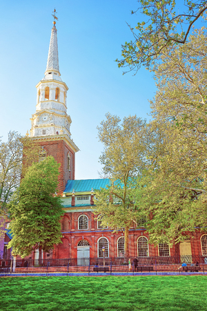 Independence Hall in Chestnut Street in Philadelphia, of Pennsylvania, USA. It is the place where the US Constitution and the US Declaration of Independence were adopted. Tourists in the street