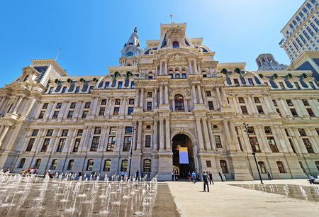 Philadelphia City Hall with a fountain on Penn Square. Tourists on the square. Pennsylvania, USA.