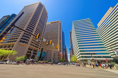 15th: Philadelphia, USA - May 4, 2015: 15th Street view of Clothespin sculpture and Skyscrapers in Philadelphia City Center. Pennsylvania, USA. Tourists in the street