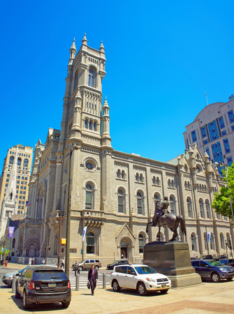 masonic: Philadelphia, USA - May 4, 2015: Masonic Temple in the Old City in Philadelphia, Pennsylvania, USA. Tourists in the street. The Temple is placed near City Hall Editorial