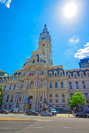 Philadelphia City Hall with William Penn monument on the Tower. View from the street. Tourists in the street Stock Photo