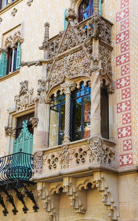 discord: Barcelona, Spain - August 14, 2011: Balcony in Casa Amatller in Modernisme style in the block of Discord in the Eixample district of Barcelona, Spain. It was designed by Josep Puig i Cadafalch