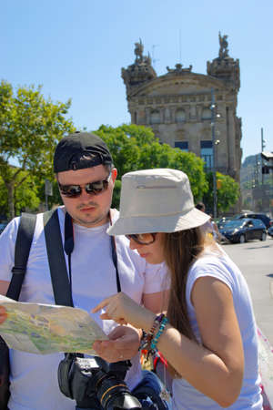 rambla: Tourists looking at a city map in La Rambla Street in the center of Barcelona, Spain. It is one of the most famous street and promenade among tourists.