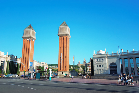 espanya: Venetian towers on Plaza de Espana of Montjuic in Barcelona in Spain. Placa Espanya is one of the most important and well-known squares in Barcelona. It is placed at the foot of Montjuic mountain. Stock Photo