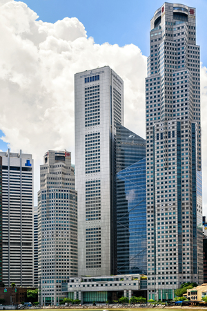 overseas: Singapore, Singapore - March 1, 2016: One Raffles Place and UOB Plaza Building in Downtown Core of Singapore skyline. United Overseas Bank is located in the Plaza