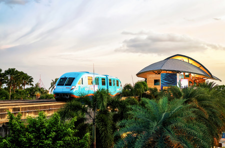 monorail: Singapore, Singapore - March 1, 2016: Sentosa Express monorail train connecting Harborfront and Sentosa Island in Singapore in the evening