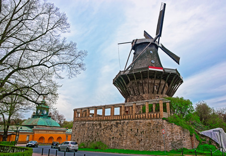 Historic Wind mill in Sanssouci Park in Potsdam in Germany. Sanssouci used to be a summer palace of King of Prussia Frederick the Great. Editorial