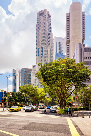 overseas: Singapore, Singapore - March 1, 2016: Boat Quay District and UOB Plaza and Downtown Core of Singapore skyline. United Overseas Bank is located in the Plaza Editorial