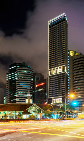 Singapore, Singapore - February 29, 2016: Skyscrapers and Telok Ayer Market at night. It is a food center in the Downtown Core of Singapore. It is also called Lau Pa Sat. Editorial