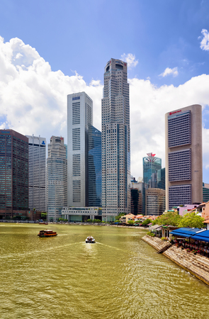 Singapore, Singapore - March 1, 2016: Skyscrapers of Downtown Core along Quay District embankment in Singapore. UOB Plaza and One Raffles Place buildings on the background.
