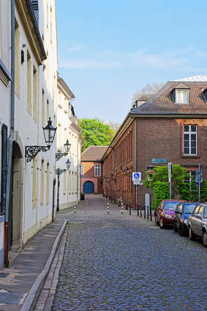 rhine westphalia: Dusseldorf, Germany - May 3, 2013: Tiny street in the Old city center of Dusseldorf in Germany. It is the capital of Rhine Westphalia region.