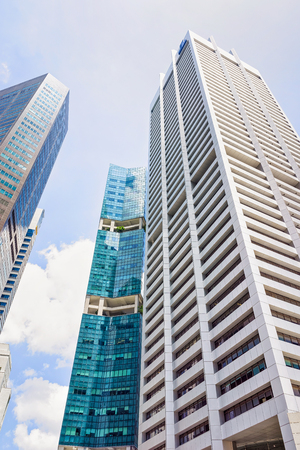 singaporean: Singapore, Singapore - March 1, 2016: Skyscrapers of One Raffles Place in Financial Center of Singapore.