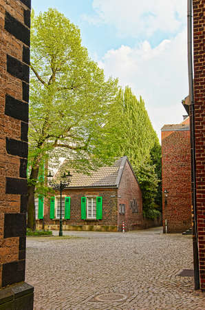 rhine westphalia: Tiny street in the Old city center of Dusseldorf in Germany. It is the capital of Rhine Westphalia region.