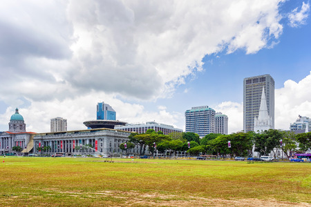 singaporean: Singapore, Singapore - March 1, 2016: Old Supreme Court, New Supreme Court, National Gallery and St Andrews Cathedral in Singapore. View from Padang, former cricket field