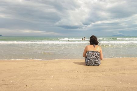 beachfront: Woman looking at the sea at the China Beach in Danang, Vietnam