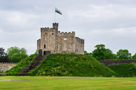 Watch Tower with a flag of Cardiff Castle in Cardiff in Wales of the United Kingdom. Cardiff is the capital of Wales.