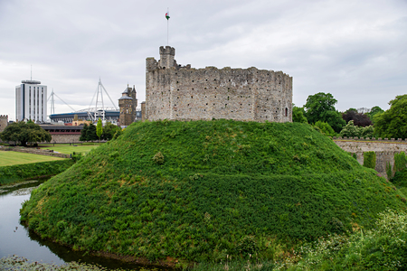 Watchtower with a flag in Cardiff Castle in Cardiff in Wales of the United Kingdom. Cardiff is the capital of Wales.