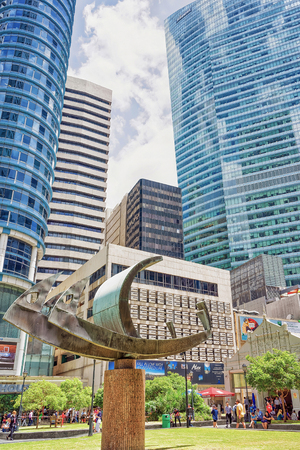 subway entrance: Singapore, Singapore - March 1, 2016: Ship sculpture at One Raffles Place MRT subway entrance in Financial Center of Singapore. People in the street.