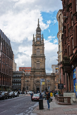 Glasgow, UK- May 8, 2011: Tourists near St George Tron Church in the Old City in Glasgow. Glasgow is the city in the Lowlands in Scotland in the United Kingdom.