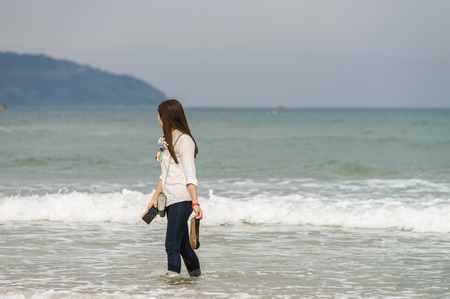 no face: Young girl in the China Beach in Danang, Vietnam. No face