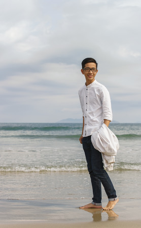 young fellow: Danang, Vietnam - February 20, 2016: Young fellow at the China Beach of Danang in Vietnam