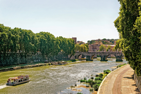Rome, Italy - August 28, 2012: Ponte Cavour Bridge over the Tiber River in Rome in Italy. View from Ponte Umberto. Specially toned in vintage style