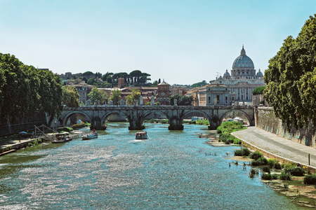 central european: Dome of Saint Peters Basilica in Vatican city and Ponte Sant Angelo Bridge over the Tiber River, in Rome in Italy. It is is also called as the Bridge of Hadrian.
