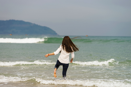 no face: Young girl on the China Beach in Danang, in Vietnam. No face