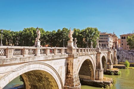 pons: Ponte Sant Angelo Bridge over the Tiber River, in Rome in Italy. It is is also called as the Bridge of Hadrian.