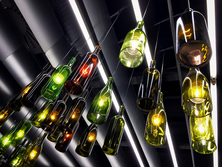 Magnificent retro light lamps decor made of wine bottles. Toned