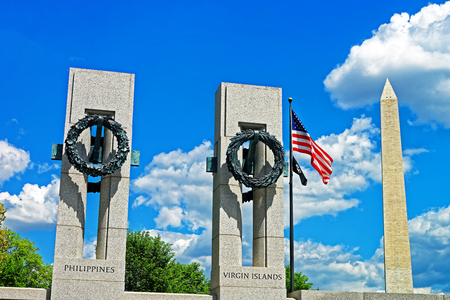 George Washington monument is pictured alongside the part of the World War II memorial in Washington D.C., USA. Both monuments are very important historic symbols for americans.