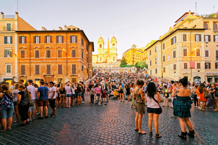 spagna: Rome, Italy - August 28, 2012: Tourists at Church of Trinita dei Monti and Egyptian obelisk at the Spanish Steps at Piazza di Spagna, in Rome in Italy. It is also called the Square of Spain.