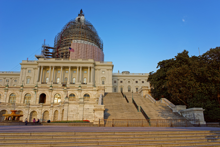 United States Capitol is being reconstructed at the picture. It can be found in the capital of the United States, Washington D.C. The main symbol of the legislative branch in the country.