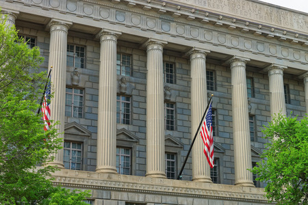 renamed: Department of Commerce is located in Herbert C. Hoover Building in Washington D.C., USA. It was built in 1932 and renamed after the former Secretary of Commerce and President in 1981. Stock Photo