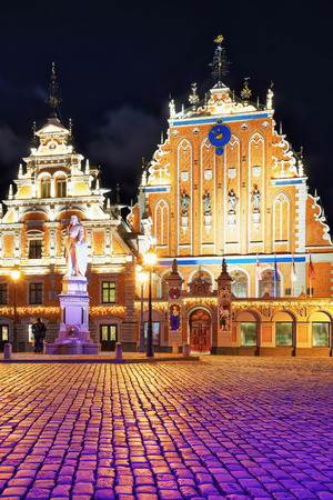 Riga, Latvia - December 26, 2015: Evening view at one of most famous building in Riga, Latvia. House of the Blackheads is located in the center of the old town. Editorial