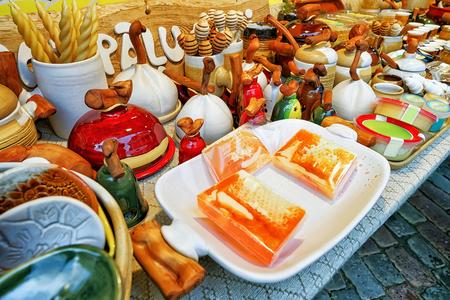 animal figurines: Riga, Latvia: Handmade honey soap and ceramics on sale during the Christmas Market in Riga, Latvia. The market is full of various festive goods, souvenirs, warm clothes