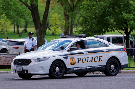 district of columbia: Washington D.C., USA - May 3, 2015: Police car and police were photographed in Washington D.C. They represent the law enforcement agency, Metropolitan Police Department of the District of Columbia.