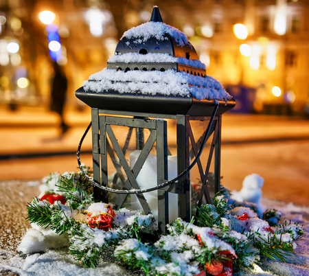 Lantern composition is one of the symbols of Christmas and New Year. This one was photographed in Vilnius, Lithuania at the annual Christmas Market. It is the symbol of cosiness in the house.