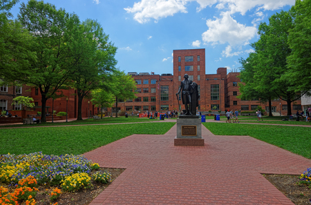 Washington D.C., USA - May 2, 2015: George Washington statue is seen in the campus of the George Washington University. It is usually called GW or GWU. Was founded on February 9, 1821.
