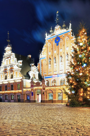 Riga, Latvia - December 26, 2015: Look at the House of the Blackheads and the Christmas tree near it during the Christmas market in Riga, Latvia.