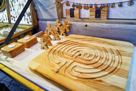 Riga, Latvia: Handmade wooden board game pictured at the Christmas Market in Riga, Latvia. At the market people can find various souvenirs. Selective focus