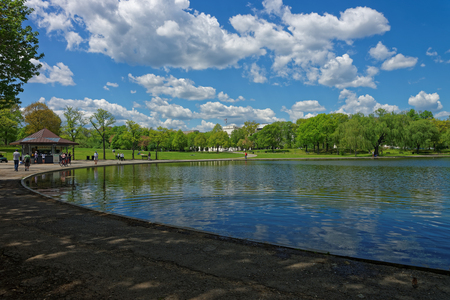 each year: Washington D.C., USA: People enjoy a beautiful day at the Constitution Gardens. It is located near the National Mall. Constitution Gardens each year welcomes millions of people.